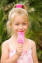 Smiling cute girl with lolly Royalty Free Stock Photo