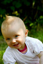 Smiling Cute infant in nature Stock Image