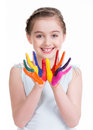 Smiling cute little girl with painted hands isolated on white Stock Image