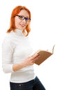 Smiling cute red-haired girl in glasses with book. Stock Photos