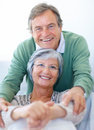 Smiling cute retired couple sitting together Royalty Free Stock Photo