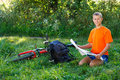 Smiling cyclist with map in hand Royalty Free Stock Photography