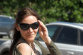 Smiling dark haired woman in sunglasses portrait Royalty Free Stock Image