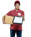 Smiling delivery man holding a paper box Royalty Free Stock Photo
