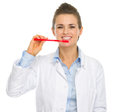 Smiling dental doctor woman showing how to clean teeth Stock Images