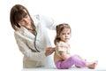 Smiling doctor examining baby isolated on white background Royalty Free Stock Photo