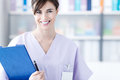 Smiling doctor holding medical reports Royalty Free Stock Photo