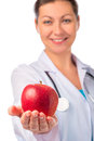 Smiling doctor holding a red apple Royalty Free Stock Photo
