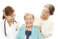 Smiling doctor with senior women Royalty Free Stock Photo
