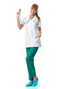 Smiling doctor in white medical gown showing stetoscope Royalty Free Stock Photos
