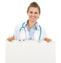 Smiling doctor woman showing blank billboard Royalty Free Stock Photo