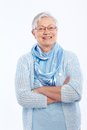 Smiling elderly lady standing arms crossed Royalty Free Stock Photos