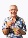 Smiling elderly man with coctail holding a in the glass straw on white background Royalty Free Stock Photo