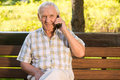 Smiling elderly man with phone. Royalty Free Stock Photo