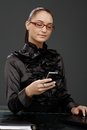 Smiling elegant businesswoman texting Royalty Free Stock Photo