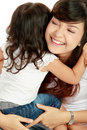 Smiling embracing mom and daughter Royalty Free Stock Photo