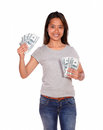 Smiling ethnic young woman with cash dollars portrait of a looking at you on isolated background Royalty Free Stock Image