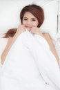 Smiling face asian woman just wake up on bed happy dream Stock Image
