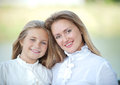 Smiling faces happy mother with daughter hug in autumn garden Royalty Free Stock Photo