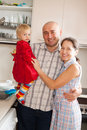 Smiling family at big kitchen relaxing brightly Royalty Free Stock Images