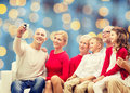 Smiling family with camera Royalty Free Stock Photo