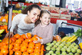 Smiling family customers buying fruits Royalty Free Stock Photo