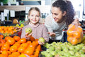 Smiling family customers buying ripe fruits Royalty Free Stock Photo