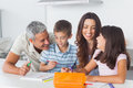 Smiling family drawing together in kitchen at home Royalty Free Stock Photos