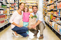 Smiling family with grocery bag at the supermarket Royalty Free Stock Photo
