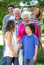 Smiling family standing in a row the garden Royalty Free Stock Images
