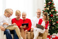 Title: Smiling family with tablet pc computers at home
