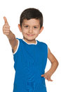 Smiling fashion little boy blue shirt holding his thumb up white background Royalty Free Stock Photography