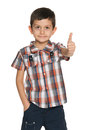 Smiling fashion little boy holding his thumb up white background Stock Image