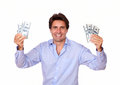Smiling fashionable man holding cash money portrait of a on isolated background Stock Photos