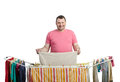Smiling fat man in red t shirt drying washing middle aged laundry on standing clothes airer dryer Royalty Free Stock Image