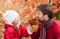 Smiling father and daughter having fun outdoor in an autumn park cheerful the during close up portrait of happy loving active Royalty Free Stock Images