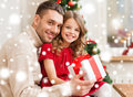 Smiling father and daughter holding gift box family christmas x mas winter happiness people concept Stock Photo