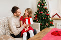Smiling father and daughter looking at each other family christmas x mas winter happiness people concept holding gift box Stock Photography