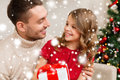 Smiling father and daughter looking at each other family christmas x mas winter happiness people concept holding gift box Stock Images