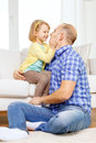 Smiling father and daughter playing at home family child happiness concept Stock Photo