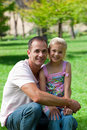 Smiling father and his daughter having a picnic Stock Images