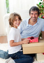 Smiling father and his son opening Christmas gifts Royalty Free Stock Images