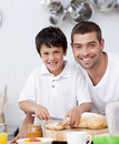 Smiling father and son preparing a toast Royalty Free Stock Images