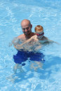 Smiling Father and Son in Swimming Pool Royalty Free Stock Photo