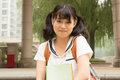 Smiling female asian student carrying her books Royalty Free Stock Photo