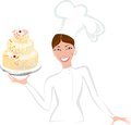 Smiling female baker with cake Royalty Free Stock Image