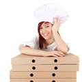 Smiling female chef with boxes of pizza Stock Images