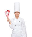 Smiling female chef with cooking equipment and food concept Royalty Free Stock Image