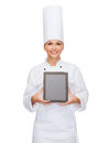 Smiling female chef with tablet pc blank screen Royalty Free Stock Photos