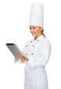 Smiling female chef with tablet pc computer Royalty Free Stock Photo